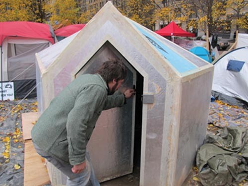Occupier Austin Zahar shows off a yurt - PHOTO BY CHRIS YOUNG
