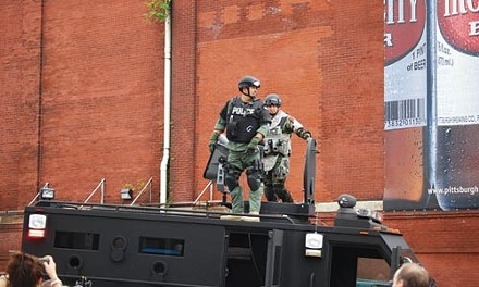 Officers deploying the sonic disruptor - CHARLIE DEITCH