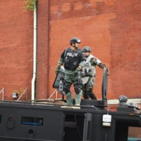 Officers deploying the sonic disruptor