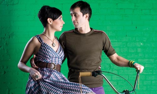 "On Bahareh: Plaid ""Poise"" dress and ""Xena"" belt, available from ModCloth.com. Steven Webster ""Superstud"" sterling-silver and mother-of-pearl necklace and ring, available at Orr's Jewelers. ""Creamsicle"" custom cruiser, available at Pro Bikes. - On James: Brown knit bike jersey, available from Built In Pittsburgh. Stretch slim slacks and wristband, both available at American Apparel. - HEATHER MULL"
