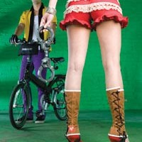 "On Bahareh: Red ruffled bicycling bloomers, by Built In Pittsburgh. Lace-up canvas cycling spats, available from fabrichorse.com. Stephen Webster sterling-silver spike cuff, available at Orr's Jewelers. ""Street Cuffs"" bike lock by Master, available at Pro Bikes.                  On James: Vintage bowling shirt, available at Eons. Stretch slim slacks, available at American Apparel. ""Classic"" gloves by Cannondale and ""Halfway"" folding bike by Giant, available at Pro Bikes."