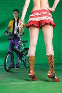 "On Bahareh: Red ruffled bicycling bloomers, by Built In Pittsburgh. Lace-up canvas cycling spats, available from fabrichorse.com. Stephen Webster sterling-silver spike cuff, available at Orr's Jewelers. ""Street Cuffs"" bike lock by Master, available at Pro Bikes. - On James: Vintage bowling shirt, available at Eons. Stretch slim slacks, available at American Apparel. ""Classic"" gloves by Cannondale and ""Halfway"" folding bike by Giant, available at Pro Bikes. - HEATHER MULL"