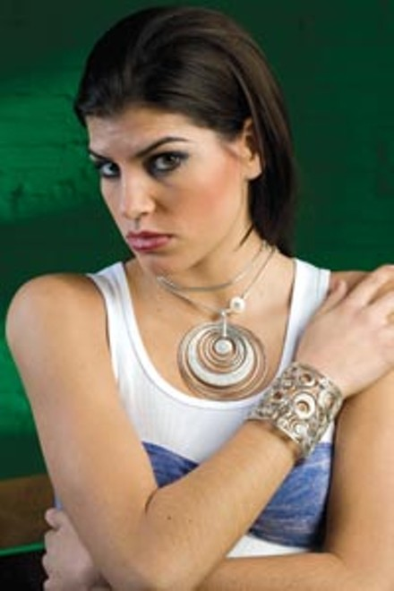 """On Danielle: John Hardy """"Langit Collection"""" sterling-silver necklace with diamond pave pendant and matching cuff, available at Orr's Jewelers. Ribbed tank and bandeau bra top, both available at American Apparel. - HEATHER MULL"""