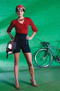 """On Danielle:  """"Mallory Keaton"""" red sweater and """"Pin-Up Girl"""" shorts, both available from ModCloth.com. Union Jack helmet by Nutcase, available at Biketek. Cycling utility belt, available from fabrichorse.com. """"Arcterra"""" sunglasses, by Specialized Optics, and """"Langster"""" single-speed road bike, by Specialized, available at Pro Bikes. - HEATHER MULL"""