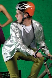 On Mike: V-neck wool sweater, silver windbreaker and stretch slim slacks, all available at American Apparel. Silver flame helmet by Nutcase, available at Biketek. - HEATHER MULL