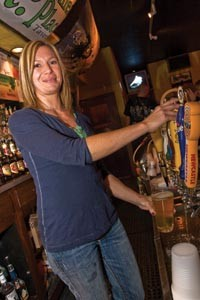 On tap, in the can or in the bottle: Becky Sauer knows her pours. - PHOTO BY BRIAN KALDORF