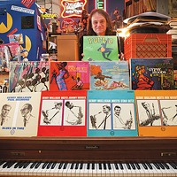 An exhibit showcases classic album covers by a forgotten local artist