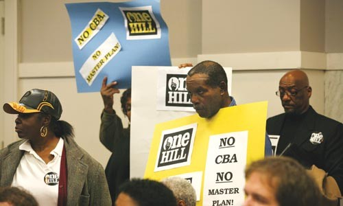 One Hill members protest arena development plans at a planning commission meeting. - HEATHER MULL
