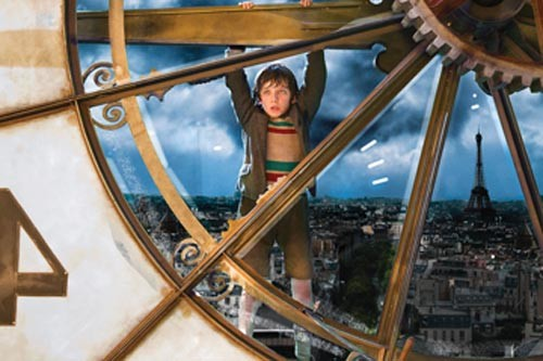 Out of time? Hugo (Asa Butterfield) hangs on.