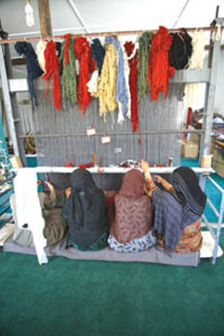 Over the objections of conservative religious officials, Emergency's Anabah hospital shelters a carpet factory run by war widows, who otherwise would have to beg for a living.