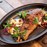 """Butcher and the Rye Pan-seard trout with cauliflower """"steak,"""" cauliflower puree, and preserved lemon. Photo by Heather Mull"""