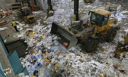 Paperwork: Recycle Management moves the pile at its Neville Island facility. - HEATHER MULL