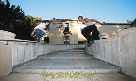 Par-corps: Local traceurs Andrew Obenreder (left), Joe Thompson and James Phillips get a jump on Oakland's Frick Fine Arts Building. - HEATHER MULL