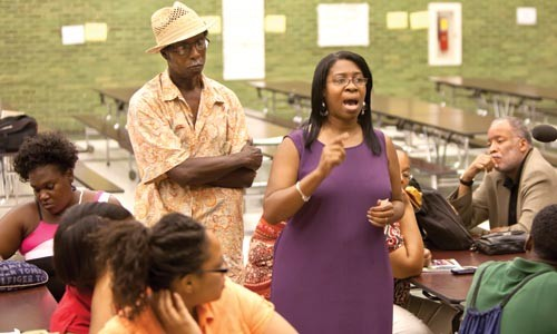 Parent Donna Simms-Key sounds off at a July 20 community meeting about the Pittsburgh School District's plans to close and consolidate several schools in the area. - JOHN ALTDORFER