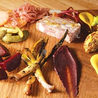 Pate board, with various pickled vegetables and spreads