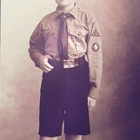 An exhibit documents the making of a Hitler youth.