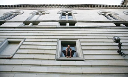 Phillips checks out the view from the Carnegie Library's main-branch building, in Oakland. - HEATHER MULL