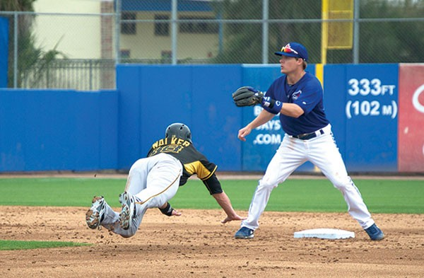 Pirates second baseman Neil Walker makes a head-first slide during an exhibition game against the Toronto Blue Jays in Dunedin, Fla., on March 5.
