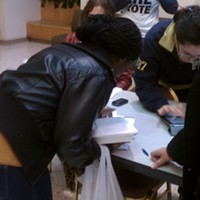 Pitt freshman Ernestina Gambrah fills out a  documentation form with Pittsburgh United after pollworkers were unable to find her name on voter rolls at the William Pitt Union