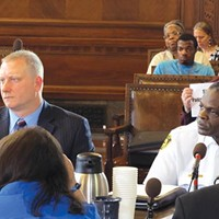 Pittsburgh Public Safety Director Michael Huss, left, and Police Chief Nate Harper discuss their concerns over a proposed police-accountability bill, while Jordan Miles (rear, in blue shirt) looks on.