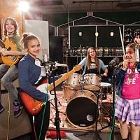 For those about to rock: Lucha Batera (left), Jasmine Liberty, program coordinator Madeleine Campbell, Lilliana Watling