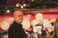 """PHOTO BY SARAH WILSON - Pittsburgh Winery owner Tim Gaber at the """"Songwriters in the Cellar"""" series"""