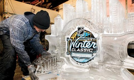 Playing it Cool: In the ice-sculpting room of Mastro Ice, on Herron Avenue in the Hill District, Kevin Heist, 40, of Chippewa, puts the finishing touches on a 500-pound NHL Winter Classic ice sculpture. The sculpture will be installed at Heinz Field on Saturday, and Mastro Ice will be producing numerous other sculptures - including an 8-by-4-foot Zamboni machine - which will be on display throughout the day. - HEATHER MULL