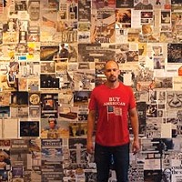"""""""Portrait of the artist with 'The Beast'"""": Will Steacy poses with his collage."""