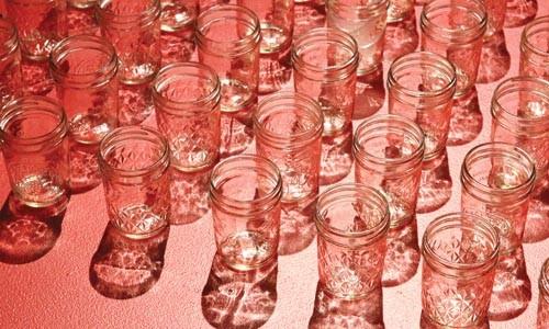 """Prohibitions: In """"Guffey Hollow,"""" empty pint jars help evoke a vanished McKees Rocks speakeasy."""