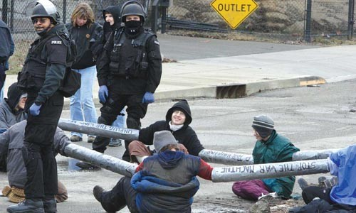 Protesters chained themselves across a road at the entrance of the NREC. - PHOTOGRAPHS BY RENEE ROSENSTEEL