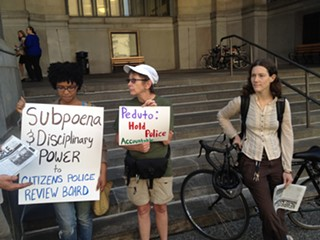 Protesters gathered outside the City-County Building this morning. - PHOTO BY ALEX ZIMMERMAN