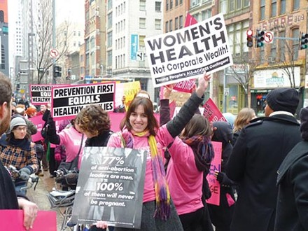 Protesters rally in support of Planned Parenthood in February.