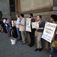 Protesters turn out for city's opening case in police contract arbitration