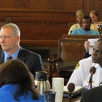 Public Safety Director Michael Huss (l) and police chief Nate Harper (r) speaking before council June 15