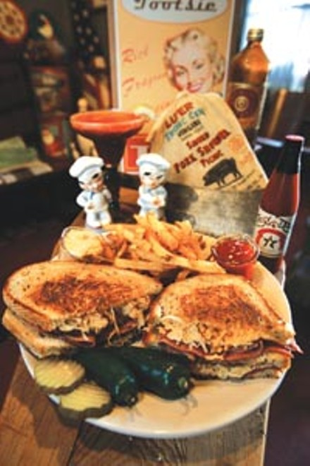 Reuben sandwich and seasoned fries - HEATHER MULL