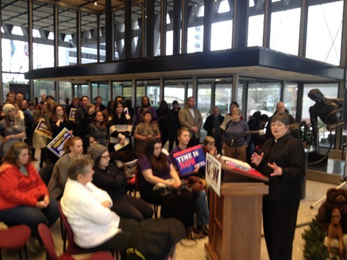 Rev. Linda Theophilus addresses a crowd at United Steelworkers headquarters this morning