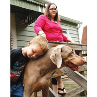Rhys Miller, with his mother, Amy McCullough, and dog Gigi