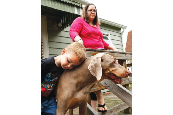 Rhys Miller, with his mother, Amy McCullough, and dog Gigi - PHOTO BY HEATHER MULL