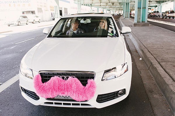 Ride-share company Lyft, and its pink-mustachioed vehicles, will launch in Pittsburgh Friday.