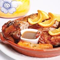 Roast suckling pig with <i>piri piri</i> sauce