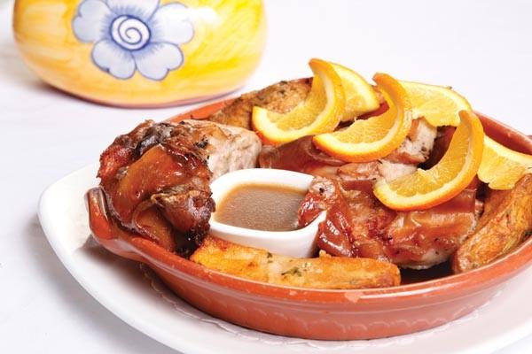 Roast suckling pig with piri piri sauce