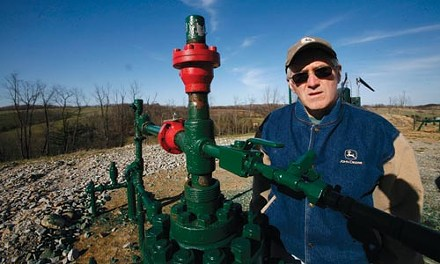 Ron Gulla stands at the site of one of four natural-gas wells on his property in Hickory, Pa. - HEATHER MULL