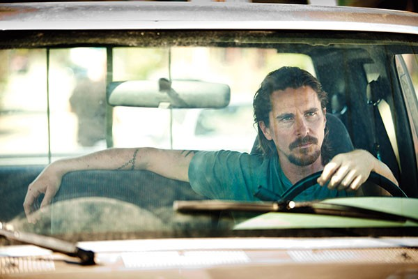 Russell Baze (Christian Bale) watches and waits.