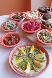 Sababa hummus (foreground), with assorted appetizers - HEATHER MULL