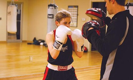 Sarah Newby practices punches with trainer David Strait in Glenshaw. - HEATHER MULL