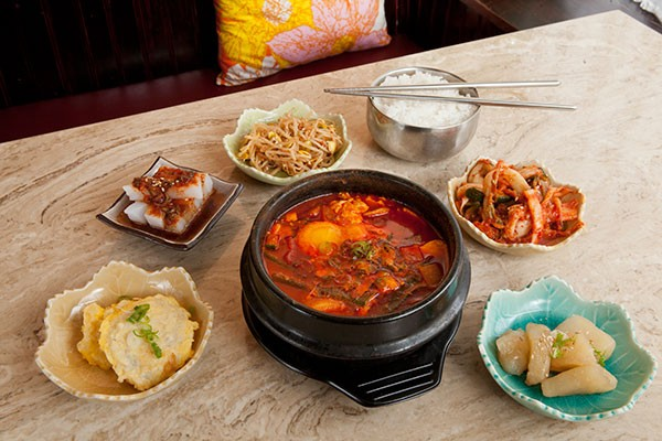Seafood soondubu (center) and side dishes - PHOTO BY HEATHER MULL