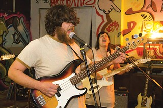 Seizure Man's Jacob Campbell, Molly Spear, playing in their band