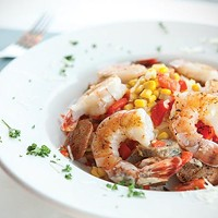 Shrimp and cheese grits, with andouille sausage, onion, corn and peppers