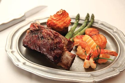 Smoked beef rib, pan-seared Gulf shrimp and sea scallop, asparagus and bacon twice-baked potato - PHOTO BY HEATHER MULL
