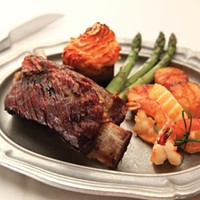 Smoked beef rib, pan-seared Gulf shrimp and sea scallop, asparagus and bacon twice-baked potato